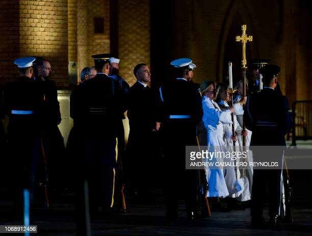 Members of the church and an honor guard wait to recieve the casket of former US President George HW Bush before carrying it into the St Martins...
