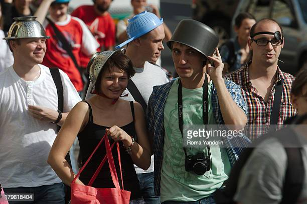 CONTENT] Members of the Church of the Flying Spaghetti Monster or Pastafarians march through St Petersburg Russia August 17 2013 The group pokes fun...