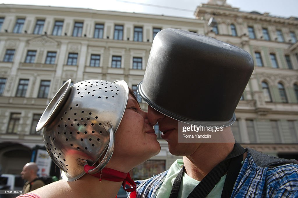 CONTENT] Members of the Church of the Flying Spaghetti Monster, or Pastafarians, kiss each others during a march through St. Petersburg, Russia, August 17, 2013. The group pokes fun at religion by worshiping a flying spaghetti monster and wearing pasta strainers on their head as religious headwear.
