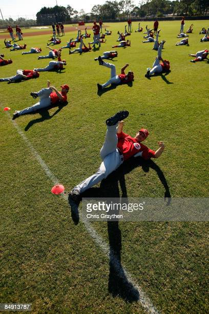 Members of the Cincinnati Reds warm up during practice after Spring Training Photo day on February 18 2009 at the Cincinnati Reds training facility...