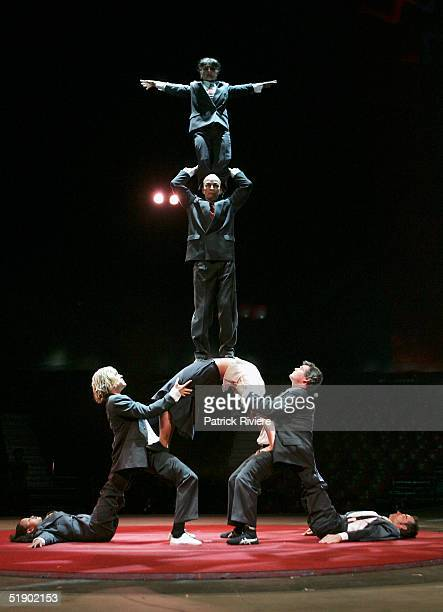 Members of the 'Circus Oz' acrobatic team perform during a rehearsal under the big top at Moore Park December 30 2004 in Sydney Australia