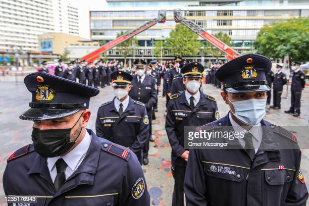 Members of the city fire department attend a memorial ceremony near the Breitscheidplatz memorial to commemorate fellow firefighters and other...
