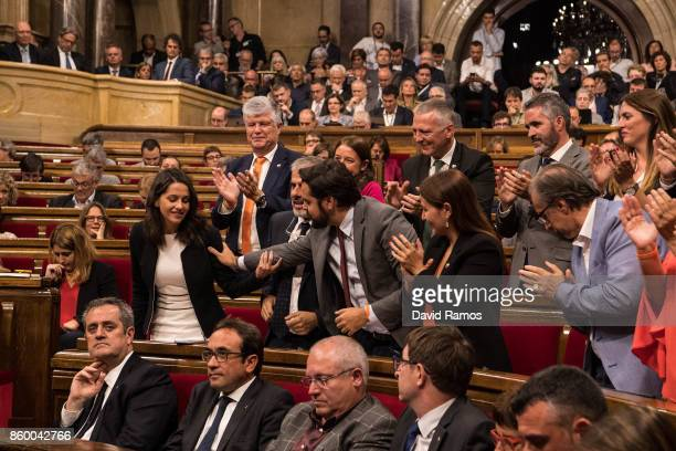 Members of the Ciudadanos party acknowledge their spokeperson Ines Arrimadas after her speech to the Catalan Parliament on October 10 2017 in...