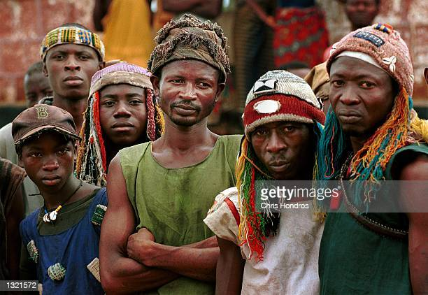 Members of the Civil Defense Force appear June 10 2001 in the eastern town of Kaliahun Sierra Leone The CDF known for their animist rituals and...