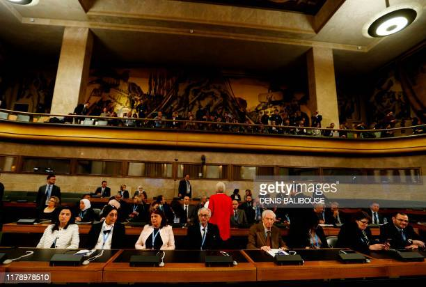 Members of the civil society delegation attend the first meeting of the new Syrian Constitutional Committee at the United Nations in Geneva on...