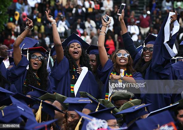 Members of the class of 2016 celebrate during the 2016 commencement ceremony at Howard University May 7 2016 in Washington DC President Obama is the...
