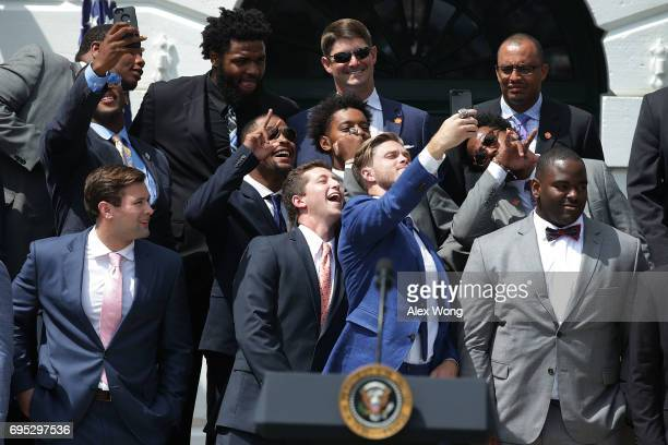 Members of the Clemson Tigers take selfies prior to a South Lawn event at the White House June 12 2017 in Washington DC President Trump hosted the...