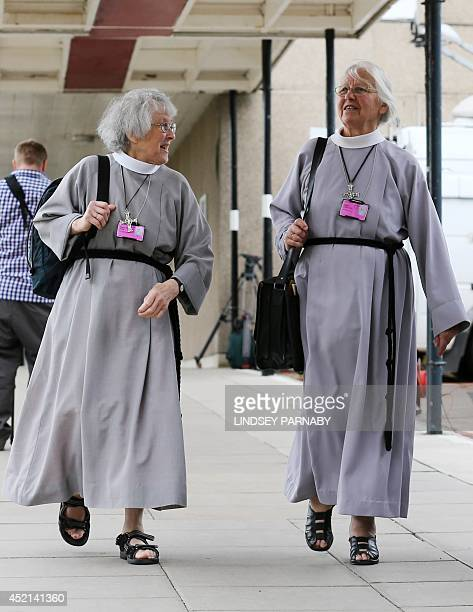 Members of the clergy arrive for the Church of England General Synod in York northern England on July 14 2014 The Church of England was debating...