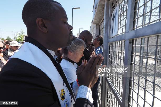 Members of the clergy pray at the entrance to the Otay Mesa Detention Center during a demonstration against US immigration policy that separates...