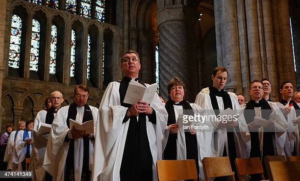 Members of the clergy sing and rejoice during the inauguration service of the Right Reverend Paul Butler in Durham Cathedral on February 22 2014 in...
