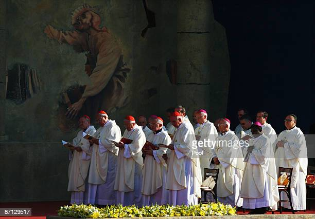 Members of the clergy take part in a mass led by Pope Benedict XVI at the Garden of Gethsemane at the foot of the Mount of Olives on May 12 2009 in...