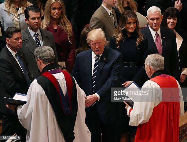Members of the clergy walk past US President Donald Trump and his wife first lady Melania Trump Vice President Mike Pence and his wife Karen Pence...