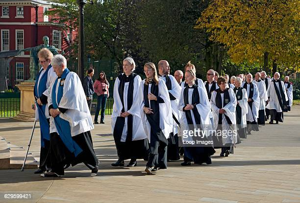 Members of the clergy walking to the Minster to attend the consecration of bishops York England