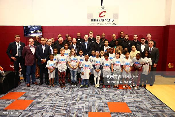 Members of the Cleveland Cavaliers NBA Commissioner Adam Silver cuts the ribbon at the 2016 NBA Finals Cares Legacy project as part of the 2016 NBA...