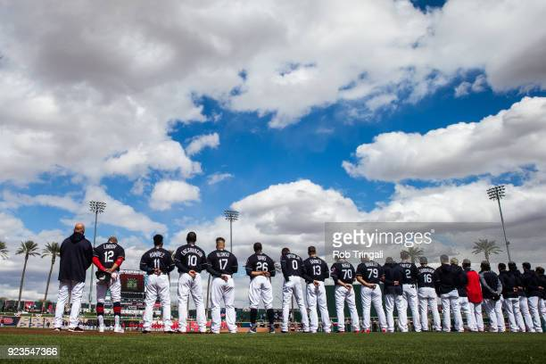 Members of the Cleveland Indians stand for the National Anthem before a Spring Training Game at Goodyear Ballpark on February 23 2018 in Goodyear...