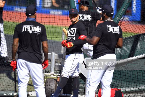 Members of the Cleveland Indians talk during batting practice prior to the game between the Kansas City Royals and the Cleveland Indians at...