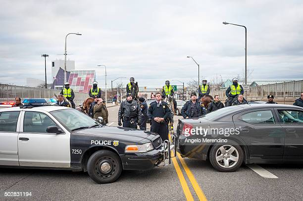 Members of the Cleveland Police Department form a roadblock on E 9th St on December 29 2015 in Cleveland Ohio Protestors took to the street the day...