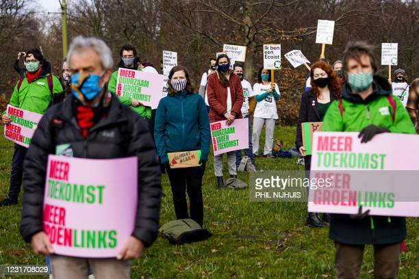 Members of The Climate Crisis Coalition, a partnership of various environmental organizations, gather during a 'Climate Alert' rally in the run-up to...