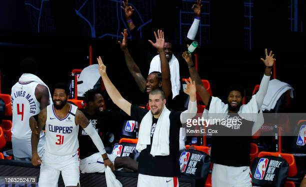 Members of the LA Clippers celebrate breaking a team three point record against the New Orleans Pelicans at HP Field House at ESPN Wide World Of...