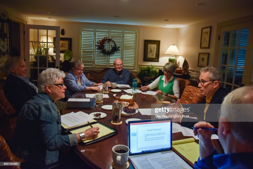 Members of the Coalition for a Planned Reston (CPR) meet at the home of Tammi Petrine, 3rd from L, one of the group's leaders, on Wednesday, April 18, 2018, in Reston, VA. The group is opposed to many of the growing changes in Reston pushed by the construction of the Metro Silver Line. Coalition for a Planned Reston (CPR) is focused on maintaining the balance of development in Reston.