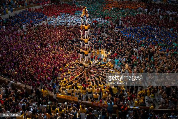 Members of the colla 'Bordegassos de Vilanova' build a human tower during the 27th Concurs de Castells competition on October 6 2018 in Tarragona...