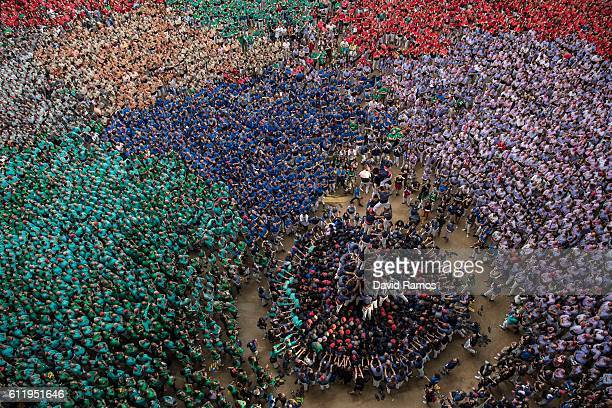 Members of the colla 'Capgrossos de Mataro' climb up as they construct a human tower during the 26th Tarragona Competition during the 26th Tarragona...