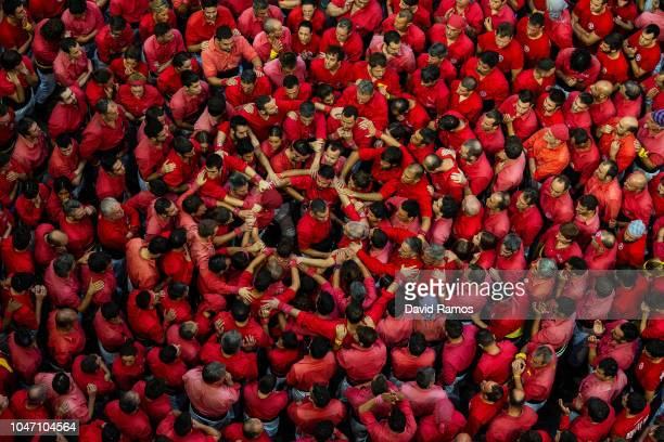 Members of the colla Castellers de Barcelona build a human tower during the 27th Concurs de Castells competition on October 7 2018 in Tarragona Spain...