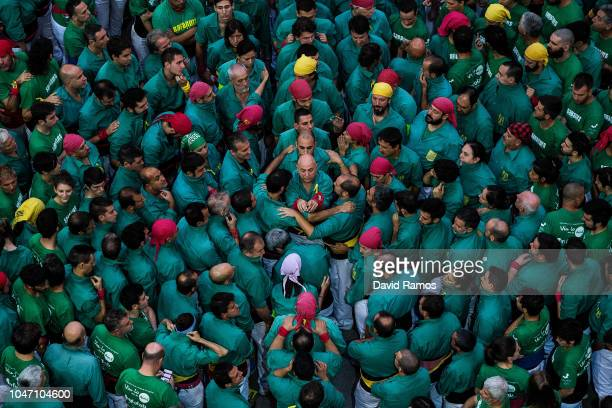 Members of the colla Castellers de Sabadells build a human tower during the 27th Concurs de Castells competition on October 7 2018 in Tarragona Spain...