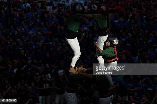 Members of the colla 'Castellers de Sant Cugat' build a human tower during the 26th Tarragona Competition on October 1 2016 in Tarragona Spain The...