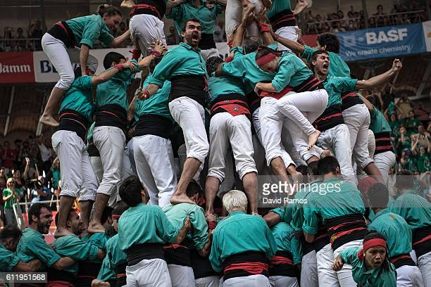 Members of the colla 'Castellers de Vilafranca' celebrate after building a human tower during the 26th Tarragona Competition on October 2 2016 in...
