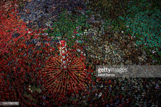 Members of the colla ' Colla Jove Xiquets de Valls' build a human tower during the 27th Concurs de Castells competition on October 7 2018 in...