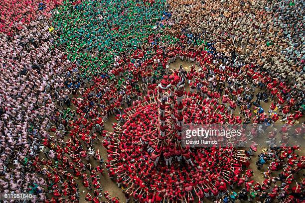 Members of the colla 'Colla Jove Xiquets de Valls' climb up as they construct a human tower during the 26th Tarragona Competition on October 2 2016...
