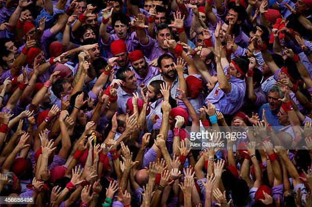 Members of the 'Colla Jove Xiquets de Tarragona' celebrate after the construction of a human tower during the 25th Tarragona Castells Competition on...