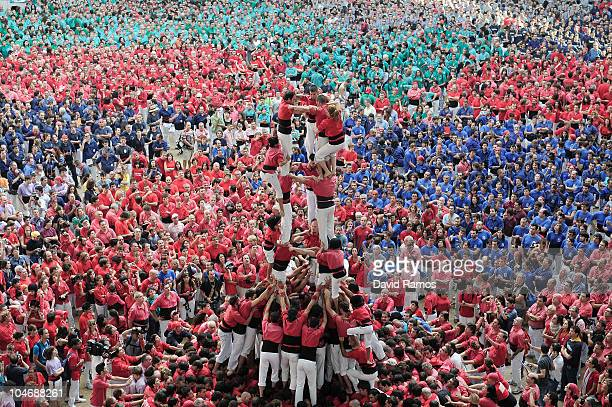Members of the Colla 'Jove Xiquets de Tarragona' climb up as they construct a human tower during the 23rd Tarragona Castells Competition on October 3...