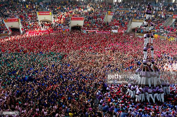 Members of the 'Colla Jove Xiquets de Tarragona' during the construction of a human tower during the 25th Tarragona Castells Competition on October 5...