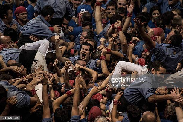 Members of the colla 'Marrecs de Salt' celebrate after building a human tower during the 26th Tarragona Competition on October 1 2016 in Tarragona...