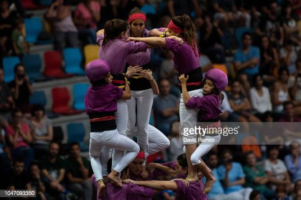 Members of the colla 'Moixigangers d'Igualada' build a human tower during the 27th Concurs de Castells competition on October 6 2018 in Tarragona...