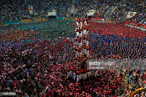 Members of the Colla 'Vella de Valls' climb up as they construct a human tower during the 24th Tarragona Castells Comptetion on October 7 2012 in...