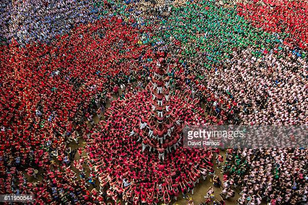 Members of the colla 'Vella de Valls' climb up as they construct a human tower during the 26th Tarragona Competition on October 2 2016 in Tarragona...
