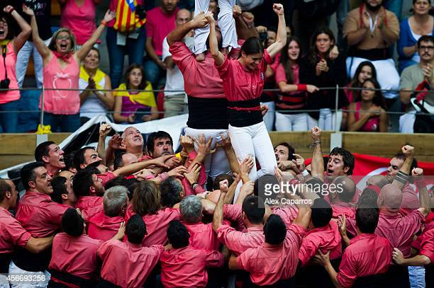 Members of the 'Colla Vella dels Xiquets de Valls' celebrate after the construction of a human tower during the 25th Tarragona Castells Competition...