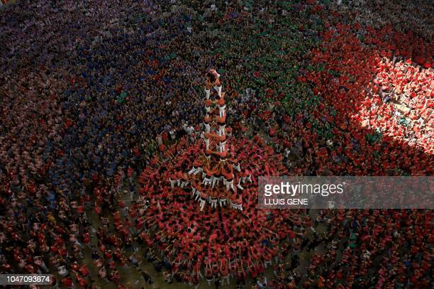TOPSHOT Members of the Colla Vella dels Xiquets de Valls human tower team form a castell winning the XXVII 'castells' competetion in Tarragona on...