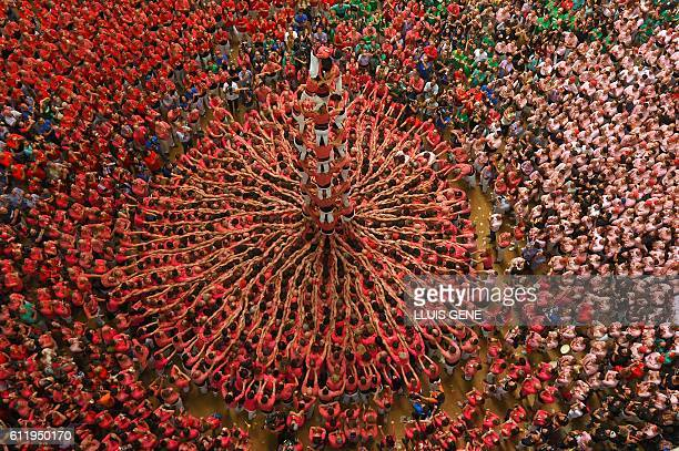 TOPSHOT Members of the Colla Vella dels Xiquets de Valls human tower team form a castell during the XXVI human towers or 'castells' competetion in...