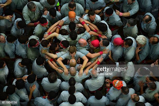 Members of the Colla Vella dels Xiquets de Valls human tower team form a castell during the XXVI human towers or 'castells' competetion in Tarragona...