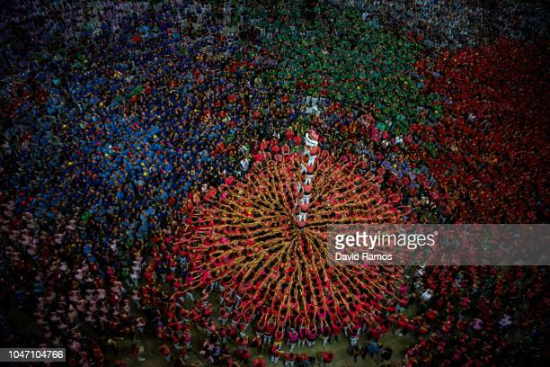 Members of the colla Vella Xiquets de Valls build a human tower during the 27th Concurs de Castells competition on October 7 2018 in Tarragona Spain...