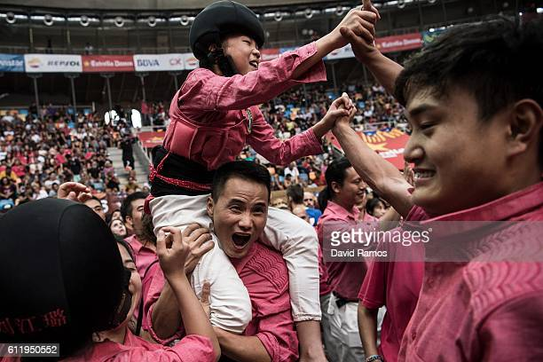 Members of the colla 'Xiquets de Hanghzou' celebrate after building a human tower during the 26th Tarragona Competition on October 1 2016 in...