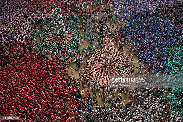 Members of the colla 'Xiquets de Reus' climb up as they construct a human tower during the 26th Tarragona Competition during the 26th Tarragona...