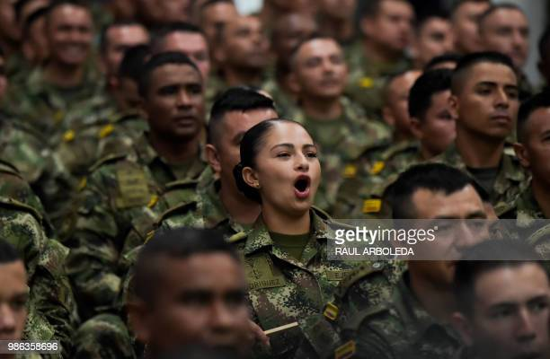 Members of the Colombian army watch the FIFA World Cup match between Colombia and Senegal at a military base in Tolemaida Colombia on June 28 2018...