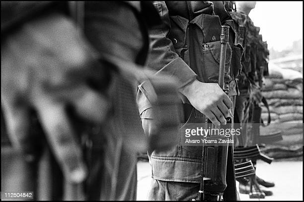 Members of the Colombian national police force at a checkpoint in Chilvi. Chilvi used to be a stronghold for the Rostrojos, a right-wing paramilitary...