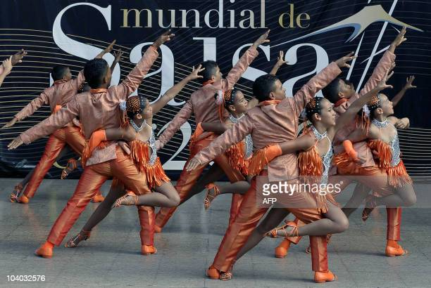 Members of the Colombian Rumba con clase Dance School perform during the children's category qualifying of the 5th World Salsa Festival on September...