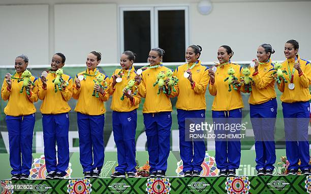 Members of the Colombian synchronised swimming team pose on the podium with their silver medals after the technical routine final competition at the...